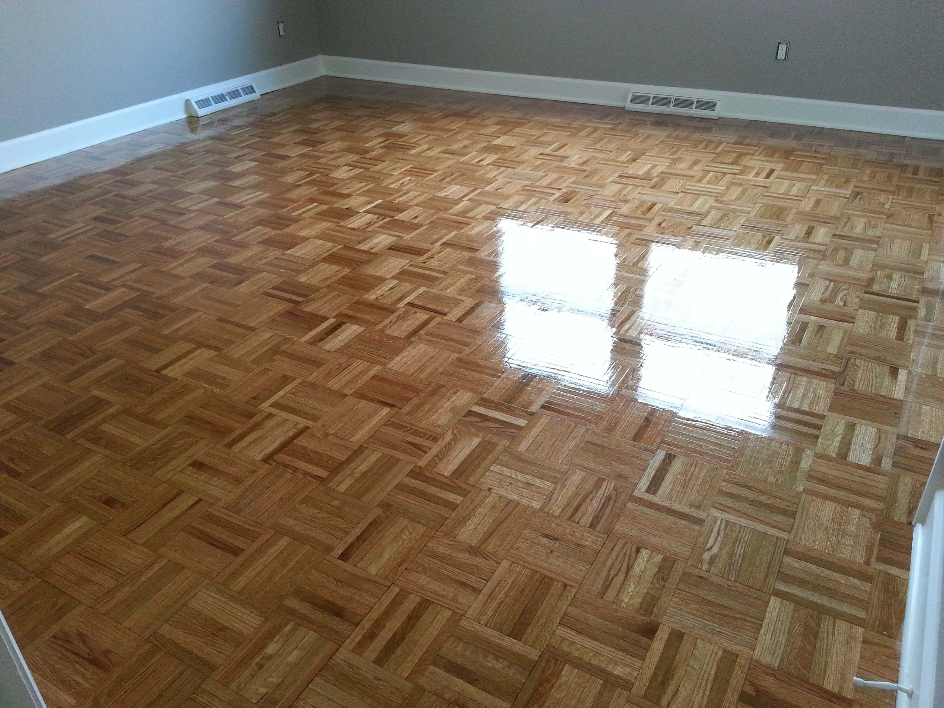 A recently refinished parquet hardwood floor