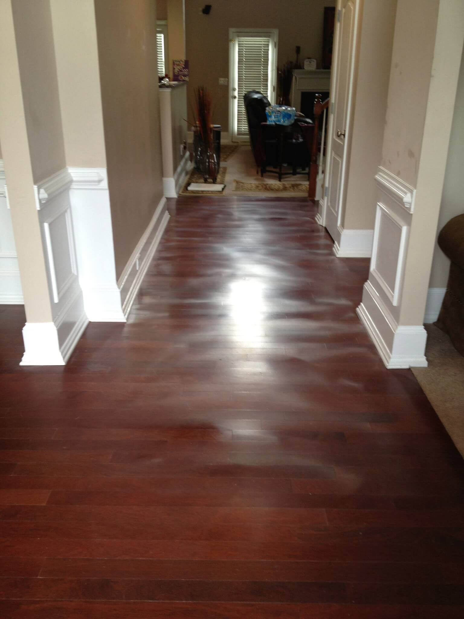a warping and horribly damaged hardwood floor