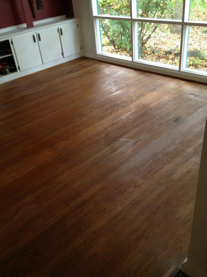 a hardwood floor in need of some updates.