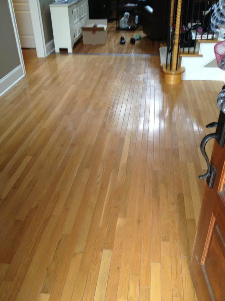 light brown hardwood floor in need of resurfacing