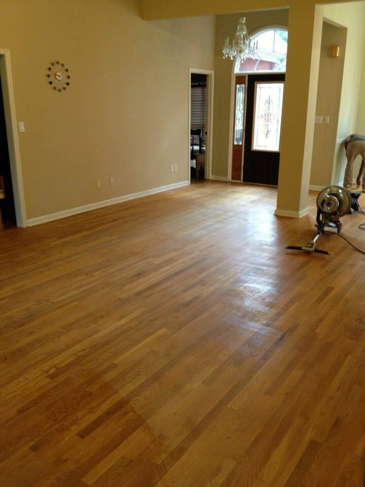 Hardwood floor with a few scratches here and there.
