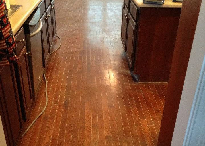 a damaged wood floor that needs to be resurfaced